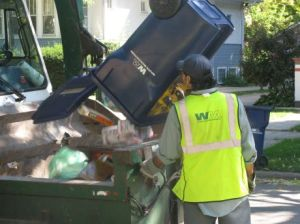 A worker empties a recycling cart in Oak Park in 2010 (photo: Jim Jaworski)