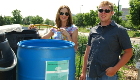 Mary Rasic and Kevin Markowski will no longer have to fill water barrels at the Schaumburg Campus garden (photo: M. Radeck, 2014)