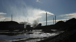 Picture of Water Sprinklers Dousing Petcoke Piles. Courtesy of E. Jason Wambsans / Chicago Tribune